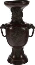 Asian:Japanese, A Japanese Patinated Bronze Urn, Meiji Period. 23 inches high (58.4cm). PROPERTY FROM THE ESTATE OF MR. AND MRS. WILLIAM ...