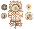 Miscellaneous:Ephemera, Group of five celluloid pins, including two Queen VictoriaMemoriam, one attached to a wood filigree wall mount,1901; oneEdwa... (Total: 5 Items)