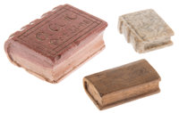 "Group of three hand-carved miniature books; one wood and two stone, one of which is engraved ""With Love to Ina rect..."