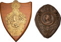 Miscellaneous:Ephemera, Two Victorian Golden Jubilee commemorative plaques, including: Onebrass on wood shield. Unidentified maker. [and:] On... (Total: 2Items)