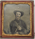 Photography:Ambrotypes, SIXTH PLATE EARLY WAR RUBY AMBROTYPE OF A HEAVILY ARMED CONFEDERATE IN BATTLE SHIRT....