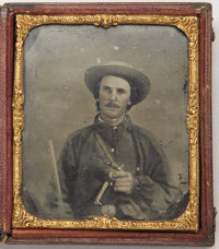 SIXTH PLATE EARLY WAR RUBY AMBROTYPE OF A HEAVILY ARMED CONFEDERATE IN BATTLE SHIRT