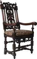 Furniture : Continental, A Gothic Revival Carved Walnut and Oak Armchair with Caned Seat and Upholstered Cushion, mid 19th century. 50-3/4 inches hig...