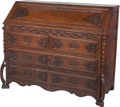 Furniture : Continental, A Continental Carved Oak Slant Front Desk, early 19th century. 40inches high x 47-1/2 inches wide x 21-1/2 inches deep (101...