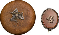 "Brass on amber brooch with ""Isle of Man"" symbol. [n.d.]. Complete with original leather box"