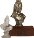Miscellaneous:Ephemera, Two small busts of Queen Victoria. Unknown makers, 1897. Largest.brass on wood stand, smaller molded clear glass.. ... (Total: 2Items)