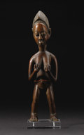 African: , Baule (Côte d'Ivoire). Standing female figure holding her breasts.Wood, beads. Height: 10 ½ inches Width: 2 7/8 inches De...