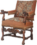 Furniture : French, A Louis XVIII-Style Upholstered and Carved Walnut Chair, early 20thcentury. 39 inches high x 21-1/2 inches wide x 23 inches...