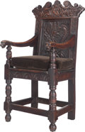 Furniture : Continental, A Renaissance Revival Carved Oak Arm Chair, 19th century. 48 incheshigh x 22 inches wide x 22-1/2 inches deep (121.9 x 55.9...