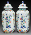 Asian:Chinese, A Pair of Chinese Polychrome Porcelain Covered Urns, 20th century. Marks: (six-character marks). 18-1/2 inches high (47.0 cm... (Total: 2 Items)