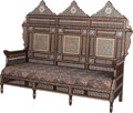 Furniture : Continental, A Moorish Upholstered Hardwood Settee with Mother-of-Pearl andAbalone Inlay, 20th century. 57-1/2 inches high x 71 inches w...