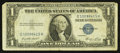 Error Notes:Foldovers, Fr. 1614 $1 1935E Silver Certificate. Fine.. ...