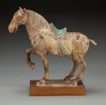 Asian:Chinese, A Chinese Tang Dynasty-Style Glazed Pottery Horse, late 19thcentury. 11-1/4 inches long (28.6 cm) . ...