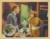 "Rain (United Artists, 1932). Lobby Card (11"" X 14""). This card reveals the core of the film, as it displays bo..."