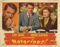 "Movie Posters:Hitchcock, Notorious (RKO, 1946). Lobby Card (11"" X 14""). This popular""two-shot"" lobby card features gorgeous photos of the Cary Grant..."