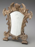 Decorative Arts, Continental, An Italian Baroque Silvered Wood Table Mirror, late 17th century inpart. 11-1/2 inches high (29.2 cm). ...