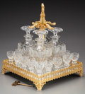 Decorative Arts, Continental:Other , A Gothic-Style Gilt Bronze Mirrored Tantalus with Four Cut-GlassDecanters and Sixteen Cordials, early 20th century. 14 inch...(Total: 22 Items)