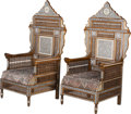 Furniture : Continental, A Pair of Moorish Hardwood Armchairs with Mother-of-Pearl andAbalone Inlay, 20th century. 57 inches high x 31 inches wide x...(Total: 2 Items)