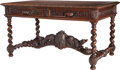 Furniture : Continental, A Continental Baroque-Style Carved Oak Two-Drawer Table withFigural Stretcher, 19th century. 30 inches high x 54-1/2 inches...