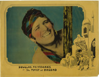 """The Thief of Bagdad (United Artists, 1924). Lobby Card (11"""" X 14""""). Douglas Fairbanks wrote this story about a..."""