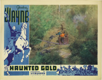 """Haunted Gold (Warner Brothers - First National, 1932). Lobby Card (11"""" X 14""""). This great card shows John Wayn..."""