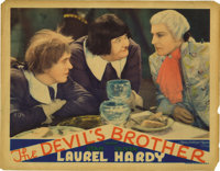 "The Devil's Brother (MGM, 1933,) Lobby Card (11"" X 14""). . Laurel and Hardy's characters are named respectivel..."
