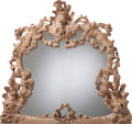 Decorative Arts, Continental, A Large German Rococo Revival Carved Walnut Mirror, late 19thcentury. 59 inches high x 65 inches wide (149.9 x 165.1 cm). ...