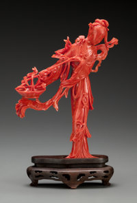 A Chinese Carved Coral Lady with Flower Basket on Stand, early 20th century 8-1/8 inches high (20.6 cm) (including