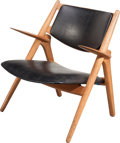 Furniture , A Hans Wegner Oak and Faux Leather Upholstered Sawbuck Chair, circa 1952. 30-1/4 inches high x 29 inches wide x ...