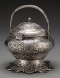 Silver Holloware, Continental, A Persian Silver Hinged and Lidded Tureen, early 20th century.Marks: T.100. 7-1/2 inches high x 8 inches diameter (19.1...