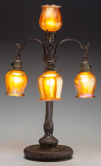 A Tiffany Studios Bronze and Gold Favrile Glass Four-Light Newel Post Lamp, Corona, New York, circa 1910 Marks to