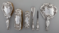 An American Art Nouveau Silver Vanity Set, early 20th century Marks: STERLING, 2000, PAT'D 10-1/8 in