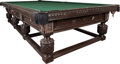 Furniture : Continental, A Victorian Oak Snooker Table with Associated Cues, circa 1890. 34inches high x 151-1/2 inches wide x 81-1/4 inches deep (8...(Total: 2 Items)