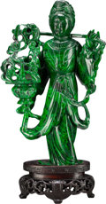 Asian:Chinese, A Chinese Carved Malachite Figure Holding a Basket with Stand.4-3/4 inches high (12.1 cm) (without stand). PROPERTY FROM ...