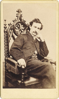 CARTE DE VISITE OF JOHN WILKES BOOTH SEATED IN CHAIR, 1865