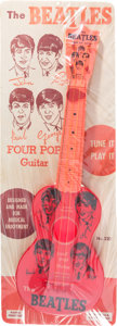 Music Memorabilia:Memorabilia, Beatles Four Pop Vintage Toy Guitar by Mastro on Original DisplayCard (NEMS, 1964). ...