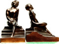 Books:Furniture & Accessories, [Bookends]. Pair of Matching Metal Bookends Depicting RecliningNude. ... (Total: 2 Items)