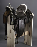 Western Expansion:Cowboy, Extremely Rare and Early Dublin Saddlery circa 1910 Texas Custom Saddle. Fully floral carved with large German silver corner...