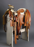 Western Expansion:Cowboy, Mexican Silver Mounted Saddle. This amazing item measuresapproximately 30 inches long, 13 inches wide and 16 inches high.T...