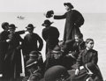Photographs:Gelatin Silver, Herbert List (German, 1903-1975). Young Priests, Waterside.Gelatin silver. 8-7/8 x 11-1/2 inches (22.5 x 29.2 cm). The ...