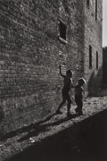 Photographs, David Martin Heath (American, b. 1931). Chicago (two boys in an alleyway), 1955-56. Gelatin silver, printed later. 10-3/...
