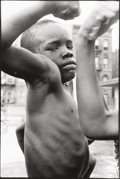 Photographs:Gelatin Silver, Leonard Freed (American, 1929-2006). Muscle Boy, Harlem,N.Y., 1963. Gelatin silver, printed later. 11-3/4 x 7-3/4inche...