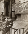 Photographs:Gelatin Silver, Jeanne Ebstel (American, 20th Century). Two boys leaning on ironfence of 1940s. Gelatin silver. 8-1/2 x 7-1/4 inches (2...