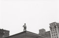 Photographs, Simpson Kalisher (American, b. 1926). Untitled (boy on rooftop), circa 1959. Gelatin silver. 8-1/2 x 13-1/4 inches (21.6...