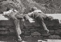 Photographs, Bernd Lohse (German, 1911-1995). Two kids on a wall. Gelatin silver. 6-3/8 x 9-1/8 inches (16.2 x 23.2 cm). Signed and w...
