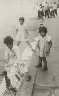 Photographs:Gelatin Silver, Helen Levitt (American, 1913-2009). New York City (three kids at curb), circa 1939. Gelatin silver. 3-1/4 x 2 inches (8....