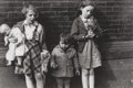 Photographs, Helen Levitt (American, 1913-2009). Three Children, circa 1940. Gelatin silver. 4-7/8 x 7-1/8 inches (12.4 x 18.1 cm). S...