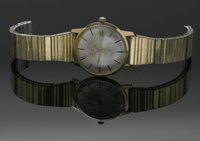 A GOLD MEN'S WRIST WATCH Lord-Elgin  The men's wristwatch with expandable segmented band, missing clasp and face marked...