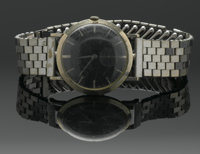 A MEN'S WHITE GOLD WRIST WATCH Bulova  The 14k white gold wristwatch, circular case with a black double dial dashed face...
