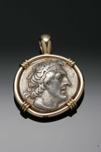 A FALCON AND FACE MEDALLION PENDANT Maker unknown  The antique reproduction coin pendant with face to the obverse, falco...